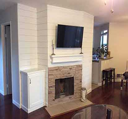 Entertainment center built above fire place in SoCal home