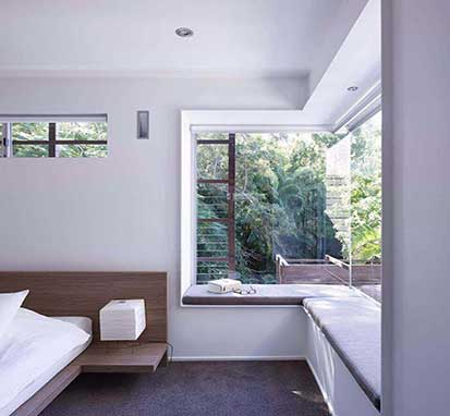 Window seat built into a bedroom of a modern home
